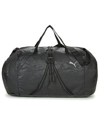 PUMA - Fit At Sports Duffle Women's Sports Bag In Black - Lyst