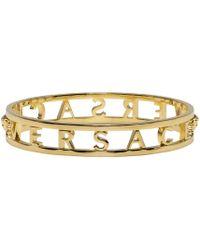 Versace   Metallic Gold Logo Bangle   Lyst