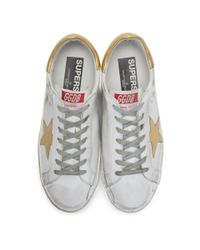 Golden Goose Deluxe Brand White And Gold Superstar Sneakers for men
