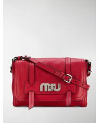 9657a12e6f21 Lyst - Miu Miu Red Logo Buckle Leather Satchel Bag in Red