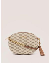 1affdd43694f Michael Kors Ginny Medium Logo Crossbody Bag in Natural - Lyst
