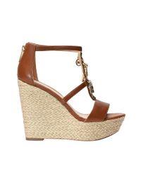 5e992efab40b Lyst - Michael Kors Suki Wedge Sandals in Brown