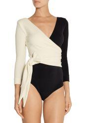 Lisa Marie Fernandez - Black Mary Helen Wrap-effect Micro-fiber Bodysuit - Lyst