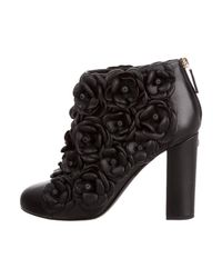 Chanel - Metallic Round-toe Camellia Booties Black - Lyst