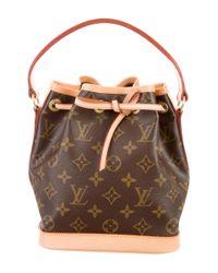 9ba302b93566 Louis Vuitton. Women s Natural Monogram Noé Bb Brown. See more Louis  Vuitton Shoulder bags.