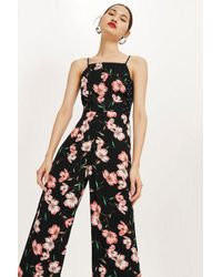 9ca012bf91 TOPSHOP Floral Spotted Bow Back Jumpsuit in Black - Lyst