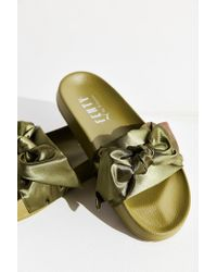 separation shoes 3c7e4 c0b47 Lyst - PUMA Fenty By Rihanna Satin Bow Slide in Green