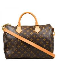 Louis Vuitton - Brown Pre-owned Speedy Bandoulière Cloth Handbag - Lyst