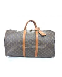 2f2985856399 Gallery. Previously sold at  Vestiaire Collective · Women s Louis Vuitton  Keepall ...