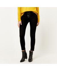 Warehouse - Black High Rise Lace Up Skinny Jean - Lyst
