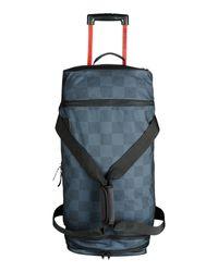Roxy - Blue Wheeled Luggage - Lyst