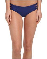 Mikoh Swimwear Velzyland Skinny String Triple Looped Bottom - Lyst
