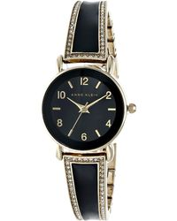 Anne Klein Ak-1028Bkgb Swarovski Crystal Accented Black And Gold-Tone Bangle Watch - Lyst