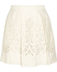 Sea Pleated Crocheted Lace Mini Skirt - Lyst