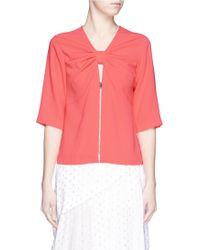 Stella McCartney Bow Cutout Front Cady Top pink - Lyst