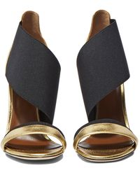 Agnona - Women's Leather Heeled Wrap Sandals In Gold And Black - Lyst