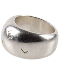 Chanel Pre-Owned Silver Stamped Name Ring - Lyst