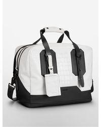 Calvin Klein Croco Embossed Duffle Bag - Lyst
