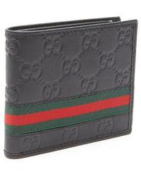 Gucci Black Sima Embossed Leather Bi-Fold Wallet - Lyst