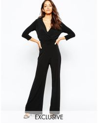 Never Fully Dressed - Plunge Neck 70s Jumpsuit With Wide Leg - Lyst