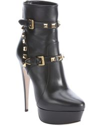 Miu Miu Black Leather Studded Platform Booties - Lyst