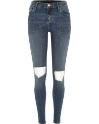 River Island Mid Wash Ripped Knee Amelie Superskinny Jeans - Lyst