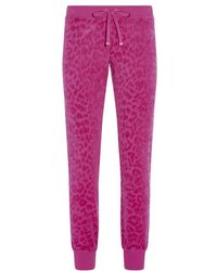Juicy Couture Leopard Flock Tapered Track Pant - Lyst
