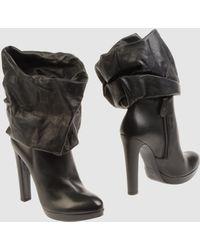 Alaïa Black Ankle Boots - Lyst