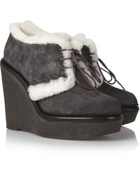 Saint Laurent Shearling-lined Suede Ankle Boots - Lyst
