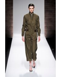 Max Mara Fall 2012 Long Sleeve Cropped Leg Military Style Jumpsuit With Attached Leather Belt In Khaki - Lyst
