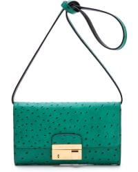 Michael Kors Clutch with Lock green - Lyst