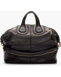 Givenchy Large Black Leather Studded Nightingale Duffle Bag - Lyst