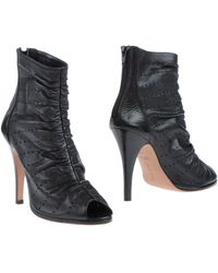 Eva Turner Ankle Boots - Lyst