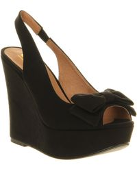 Office Orchid Bow Wedge - Lyst