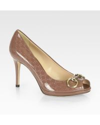 Gucci Logoembossed Patent Leather Horsebit Pumps - Lyst