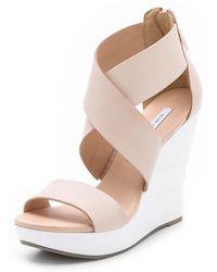 Diane von Furstenberg Opal White Lacquered Wedge Sandals black - Lyst