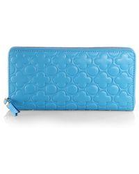Comme des Garçons Clover-Stamped Zip-Around Wallet blue - Lyst