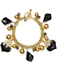 Carolee - Gilded Glimpse Charm Bracelet - Lyst