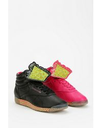 Urban Outfitters - Reebok Freestyle Keith Haring Hightop Sneaker - Lyst