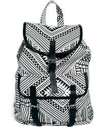 Monki - Elda Canvas Graphic Backpack - Lyst
