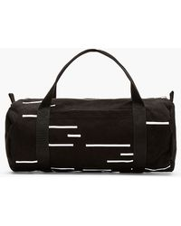 DRKSHDW by Rick Owens - Black and White Stitched Stripe Canvas Duffle Bag - Lyst