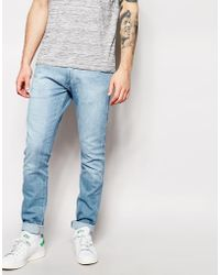 Wrangler jeans bryson skinny fit dark shadow