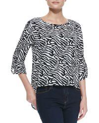 Dora Landa - Zebra-print Long-sleeve High-low Top - Lyst