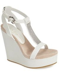 Lola Cruz Chain T-Strap Wedge Sandal white - Lyst