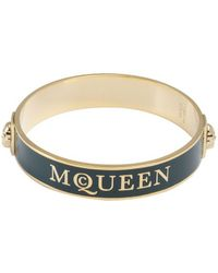 Alexander McQueen Green and Gold Enamel Logo Skull Bangle - Lyst