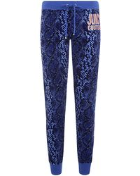 Juicy Couture Snake Tapered Track Pants - Lyst