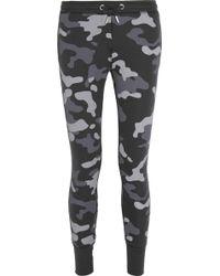 Zoe Karssen Camo-print Cotton-blend Jersey Track Pants - Lyst