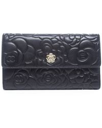 Chanel Pre-owned Black Lambskin Camellia Wallet - Lyst