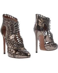 Alaïa Ankle Boots silver - Lyst