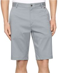 Calvin Klein Core Flat-Front Stretch Shorts gray - Lyst